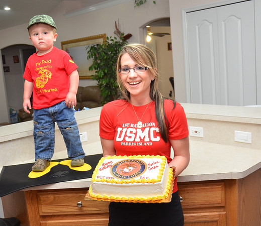 My son is in his 3rd week of Marine Corps basic training. We celebrated the Marine Corps birthday here and sent this pic to him of his wife and son.