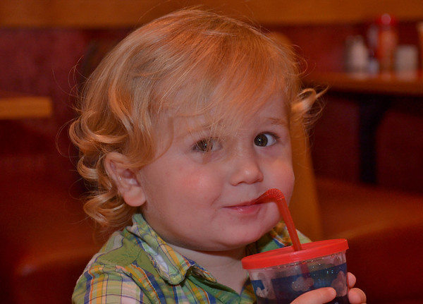 My grandson at dinner at a restaurant a couple of nights ago , just before he threw his drink across the table...