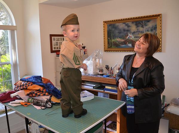 Grandson being fitted for his uniform which he will wear to his daddy's Marine Corps graduation this week